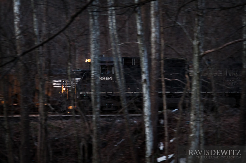 """Norfolk Southern 8864 moves a string of filled coal hoppers from the Teco Mine just west of Hurley, Virginia as darkness has long ago started to set in on the hollar.  Travis Dewitz <a href=""""http://www.therailroadcollection.com/latest-works/"""" target=""""_blank"""">The Railroad Collection</a>"""