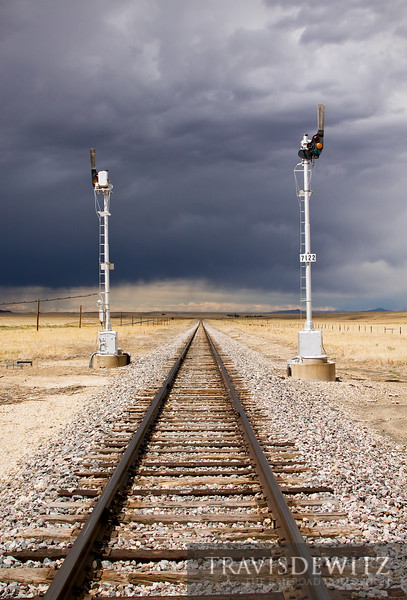 """A thunderstorm brews to the north near Springer, New Mexico as a pair of old Sante Fe semaphores still guard the tracks for BNSF and Amtrak.  Travis Dewitz <a href=""""http://www.therailroadcollection.com/latest-works/"""" target=""""_blank"""">The Railroad Collection</a>"""