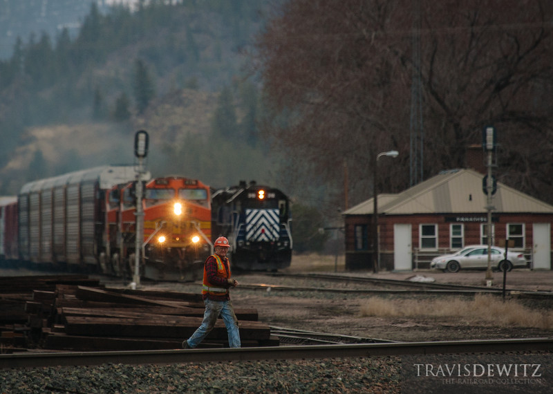 A BNSF freight waits at Paradise, Montana as some maintenance work gets finished. Once the MOW crew is clear, the frieght can continue east towards Missoula and the yard crew can get back to work.