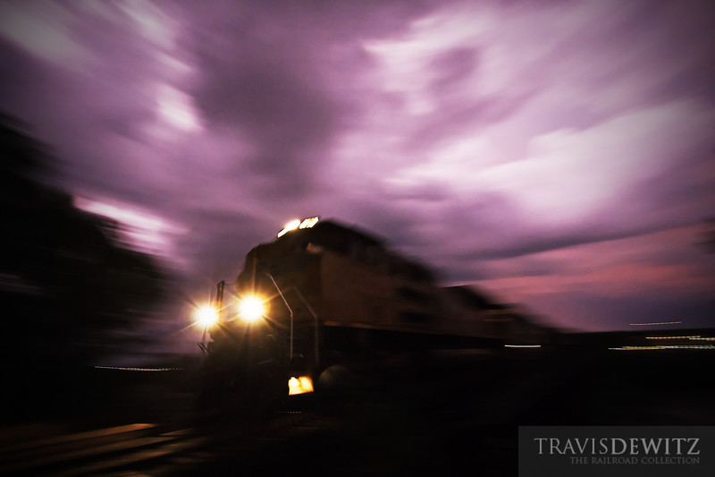 """An Union Pacific freight train thunders west over the Chippewa River under threatening skies in Eau Claire, WI.  Travis Dewitz <a href=""""http://www.therailroadcollection.com/latest-works/"""" target=""""_blank"""">The Railroad Collection</a>"""