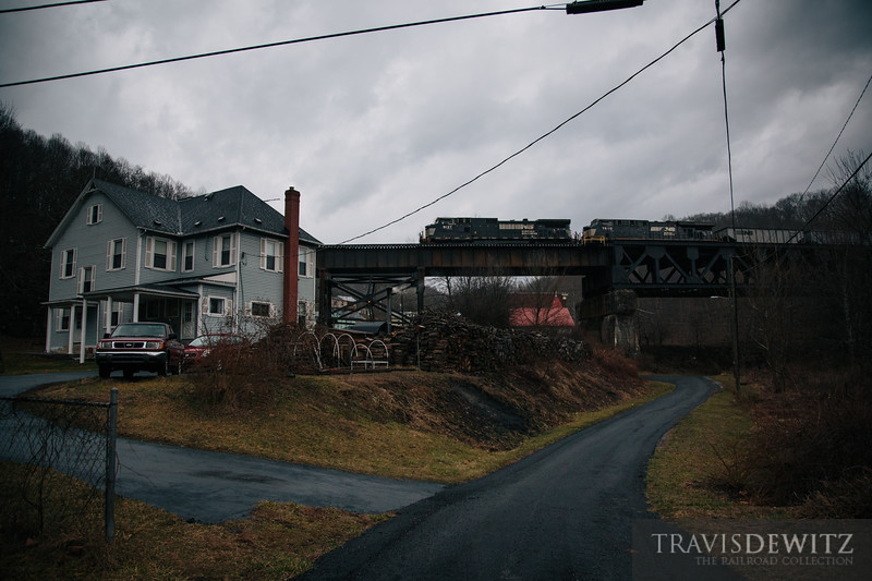 Another Norfolk Southern coal train glides over a home in Coopers, West Virginia.