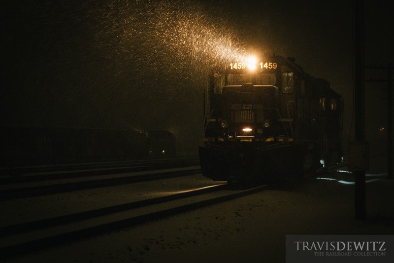 Union Pacific 1495's head light cuts through the blizzard like conditions in Altoona, Wisconsin. The yard job can also be seen working.