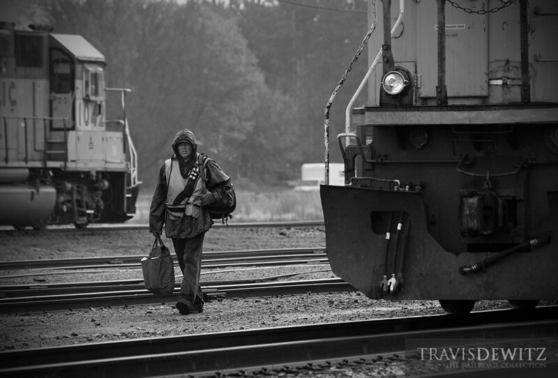 "With grip in hand, a crew member ends his shift on this dreary October day in Altoona, Wisconsin.  Travis Dewitz <a href=""http://www.therailroadcollection.com/latest-works/"" target=""_blank"">The Railroad Collection</a>"