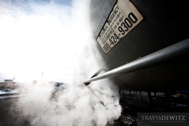 A railway tank car get filled in La Crosse, Wisconsin creating a cloud of steam.