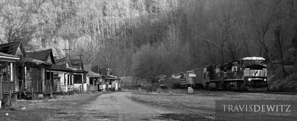 A row of houses in Kyle, West Virginia face the Norfolk Southern's Pocahontas Division. Here a freight can be seen working up grade heading east towards Bluefileld.  Travis Dewitz The Railroad Collection