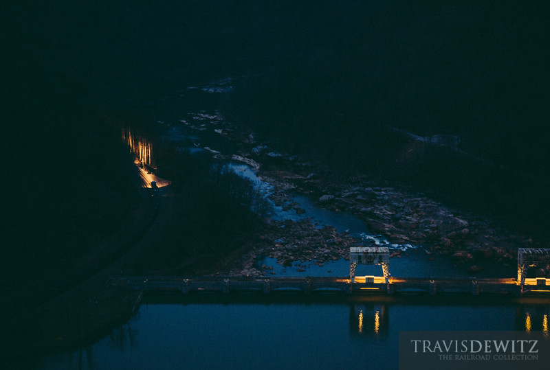 A CSX coal train sweeps along the New River and past the Gauley Dam at dawn.