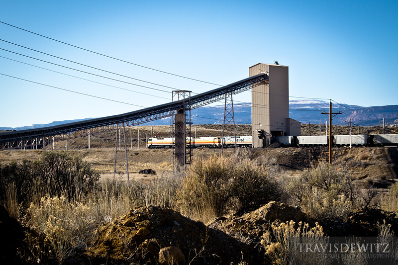 The Deseret Power Railway's coal train has just arrived at the coal loading facility near Rangely, Colorado. The Deseret Power Railway is an all electric railroad that hauls coal from this loadout to the Bonanza Power Plant in Bonanza, Utah.