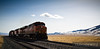 BNSF 7828 sweeps upgrade heading west towards Helena, Montana.