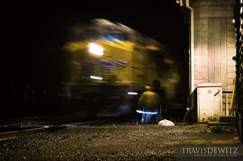 """The Operation Lifesaver train arrived into Altoona, Wisconsin in a thunderstorm the night before it was scheduled to take three trips to Chippewa Falls for presentations. The crew can be seen working in the rain aligning the switch to put the passenger train onto the east pass with Union Pacific Boyscout Unit 2010 taking up the rear.  Travis Dewitz <a href=""""http://www.therailroadcollection.com/latest-works/"""" target=""""_blank"""">The Railroad Collection</a>"""