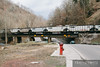 Norfolk Southern loaded Top Gons roll though Welch, West Virginia.