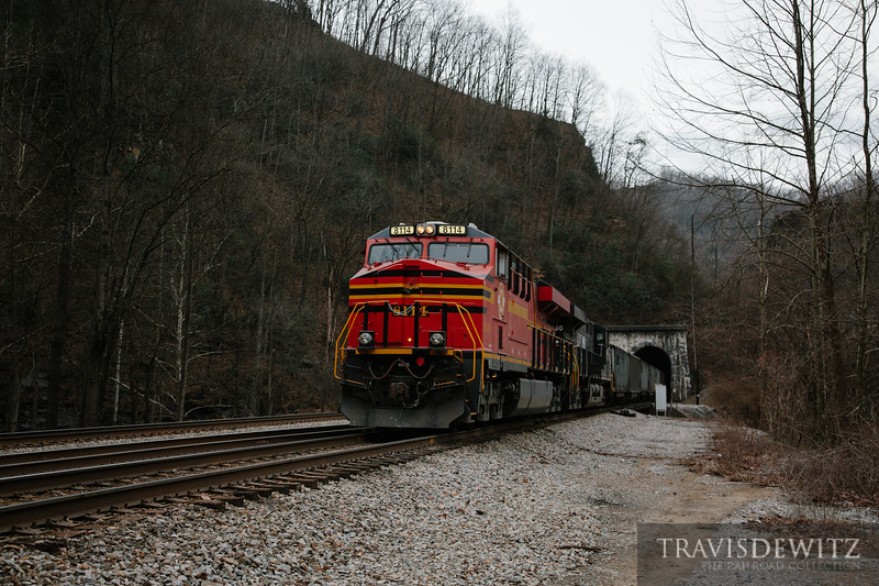 Norfolk Southern heritage unit 8114 shoves loads of coal through the Big Four tunnel.