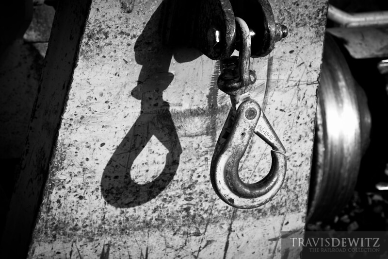 A large hook hangs in the sun from one of Montana Rail Link's MOW rail equipment near Big Timber, Montana.