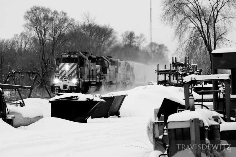 Canadian Pacific 6089 kicks up the snow as it runs down the River Sub just north of Winona, Minnesota.