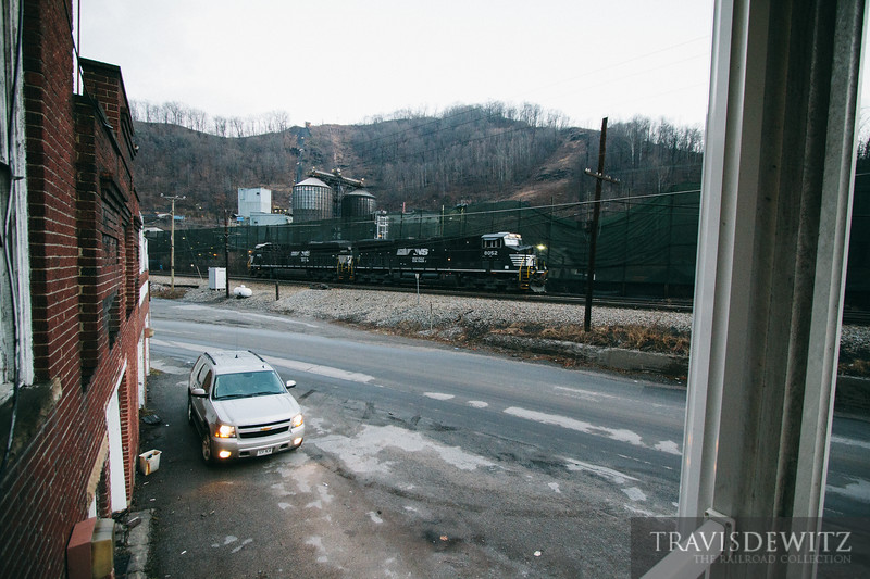 Norfolk Southern helpers roll through Keystone, West Virginia past the Bluestone Coal Company as can be seen from the steps of the old police station.