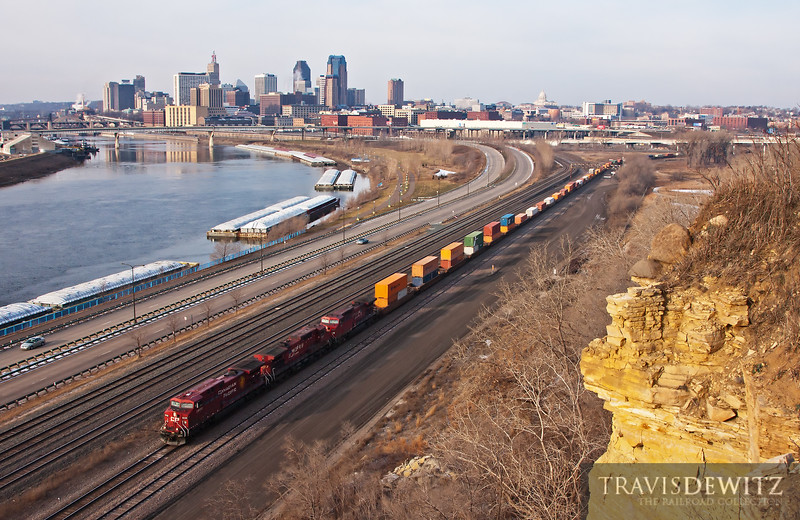 "Canadian Pacific 8608 glides under Dayton's Bluff on the way into the ex-Milwaukee Road's, Pig's Eye Yard in St. Paul, MN.  Travis Dewitz <a href=""http://www.therailroadcollection.com/latest-works/"" target=""_blank"">The Railroad Collection</a>"