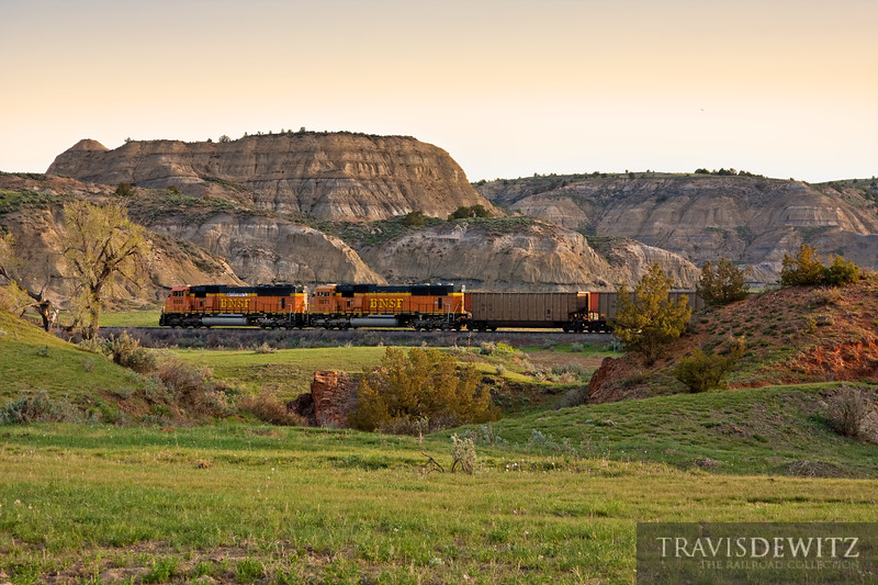 """Snaking through the Badlands of North Dakota, at Sully Springs, with empty coal hoppers heading back to the Powder River Basin.  Travis Dewitz <a href=""""http://www.therailroadcollection.com/latest-works/"""" target=""""_blank"""">The Railroad Collection</a>"""