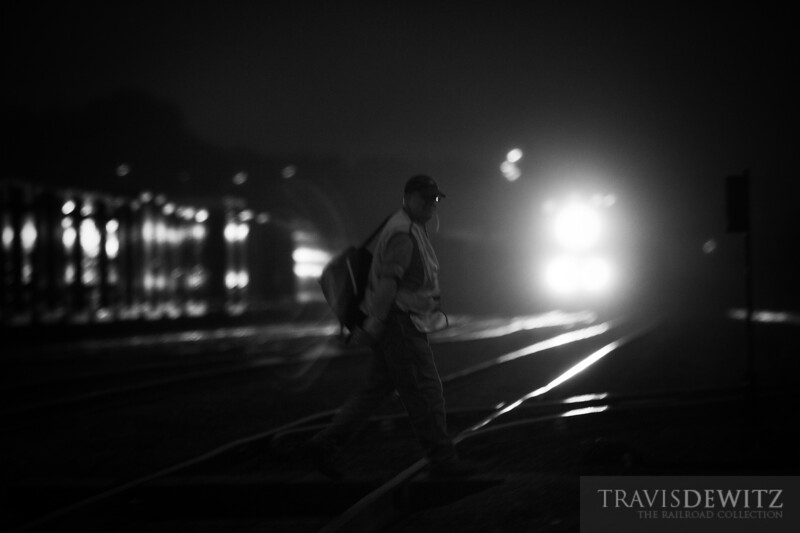 """The local job is done as an Union Pacific conductor walks across the tracks to the Altoona depot as an incoming freight pulls into the yard.  Travis Dewitz <a href=""""http://www.therailroadcollection.com/latest-works/"""" target=""""_blank"""">The Railroad Collection</a>"""