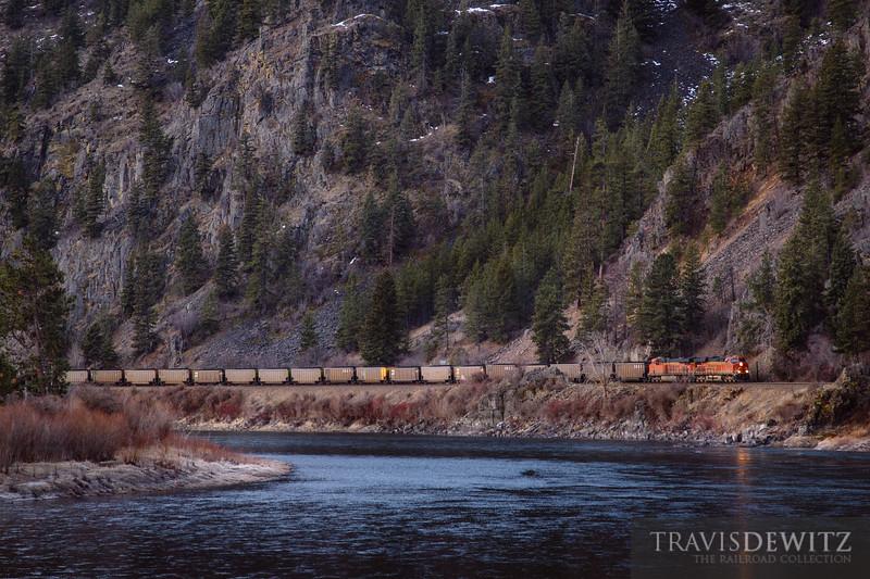 A loaded BNSF coal train works up Montana Rail Link's 4th Sub along the Clark Fork River just southeast of Paradise, Montana.