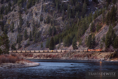 A loaded BNSF coal train works up Montana Rail Link's 4th Sub along the Clark Fork River just southeast of Paradise, Montana.