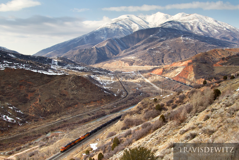 A BNSF trackage right train starts up Soldier Summit near Thistle, Utah on their way east.