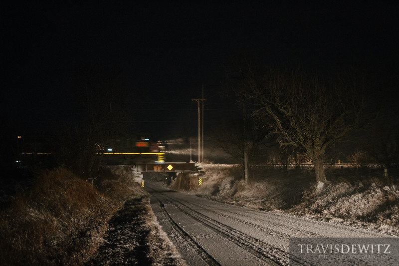 A frac train streaks across a low clearance bridge near Eagleton on the Wisconsin Northern heading north to Cameron, Wisconsin.