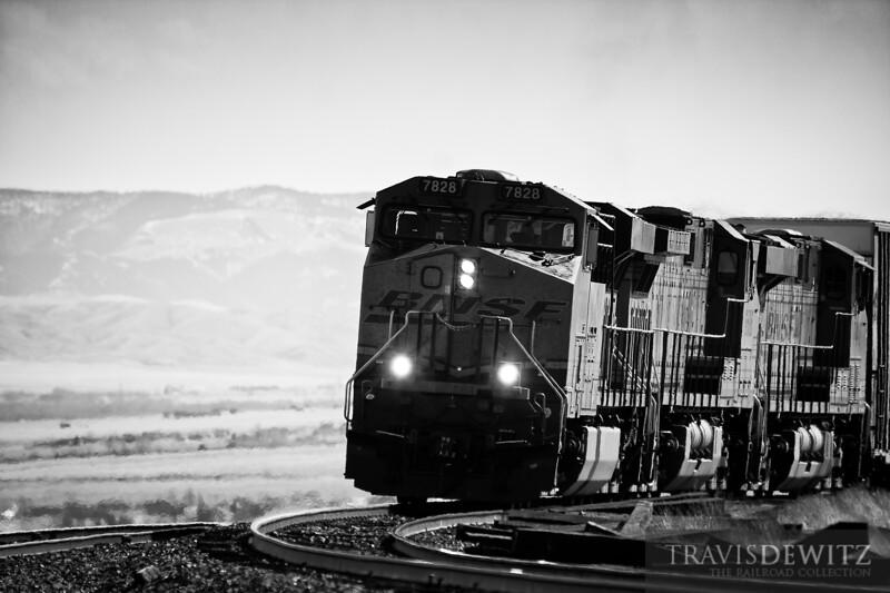 BNSF 7828 pulls west upgrade towards Helena, Montana.