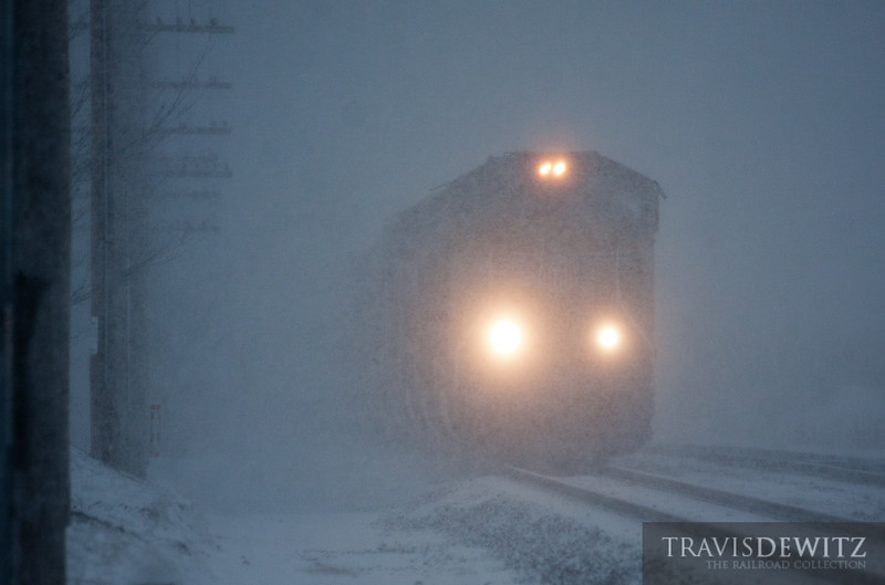 """The railroad works in every weather condition as seen here in Altoona, Wisconsin as some Union Pacific power pulls MSSPR eastbound during a blizzard.  Travis Dewitz <a href=""""http://www.therailroadcollection.com/latest-works/"""" target=""""_blank"""">The Railroad Collection</a>"""