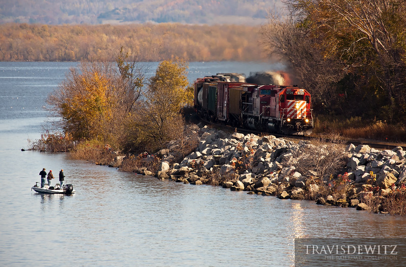 """A few fisherman enjoy their evening as Canadian Pacific SD40-2 5739 heads west up the Mississippi River at Maple Springs, Minnesota on their way towards St. Paul.  Travis Dewitz <a href=""""http://www.therailroadcollection.com/latest-works/"""" target=""""_blank"""">The Railroad Collection</a>"""