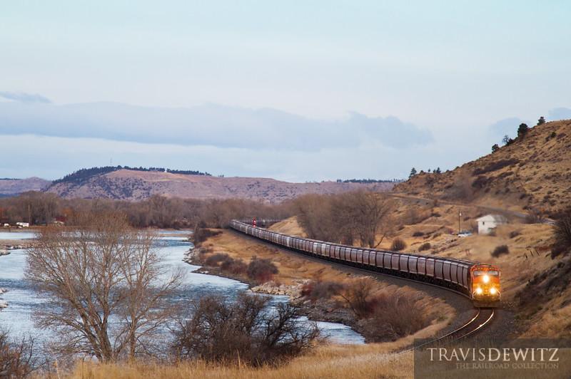 A BNSF worm train sails along the Yellowstone River Eastbound near Columbus, Montana.