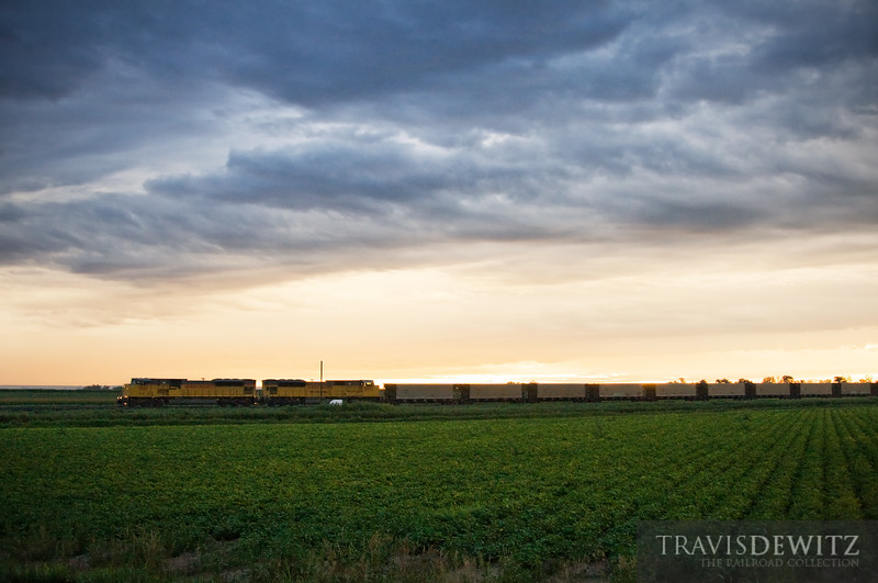 "A empty coal train flies under a gorgeous sky just outside of Scottsbluff, Nebraska in the early morning hours, on it's way back to the Powder River Basin.  Travis Dewitz <a href=""http://www.therailroadcollection.com/latest-works/"" target=""_blank"">The Railroad Collection</a>"