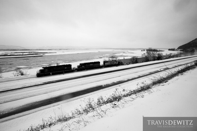 Minnesota, Dakota, and Eastern SD40-2 #6089 heads up the ice covered Mississippi River at Minneiska, Minnesota.