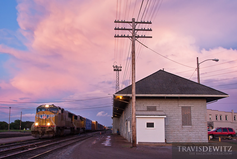 "Union Pacific MPRSS has just pulled up to the Altoona depot under an amazing sky.  Travis Dewitz <a href=""http://www.therailroadcollection.com/latest-works/"" target=""_blank"">The Railroad Collection</a>"