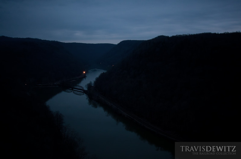 """The sun has yet to rise in the New River Gorge as a CSX coal train snakes slowly along the banks of the New River.  Travis Dewitz <a href=""""http://www.therailroadcollection.com/latest-works/"""" target=""""_blank"""">The Railroad Collection</a>"""