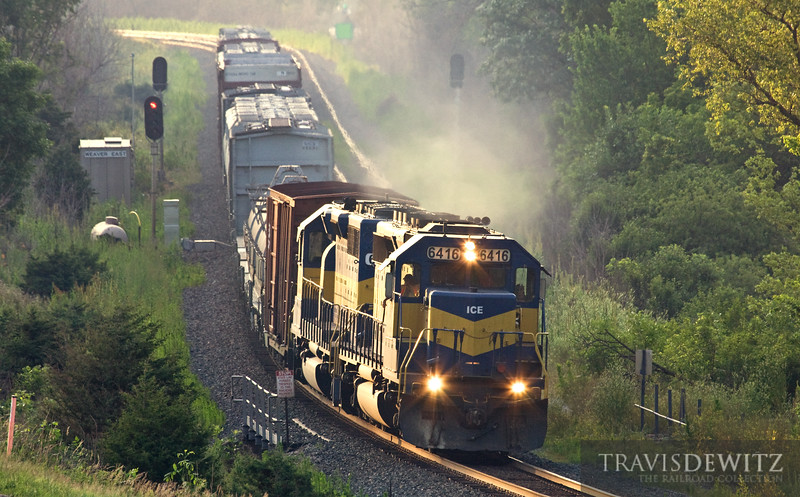 """An Iowa, Chicago, and Eastern train makes time down the Mississippi River in the late afternoon at Weaver, Minnesota.  Travis Dewitz <a href=""""http://www.therailroadcollection.com/latest-works/"""" target=""""_blank"""">The Railroad Collection</a>"""
