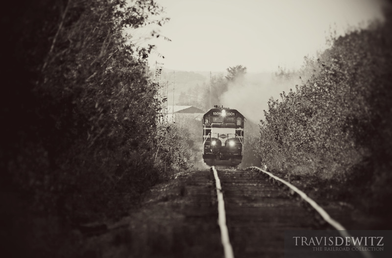 "Wisconsin Northern GP15 1501 pulls hard towards Chippewa Falls through a tunnel of trees in their fall colors near Tilden, Wisconsin.  Travis Dewitz <a href=""http://www.therailroadcollection.com/latest-works/"" target=""_blank"">The Railroad Collection</a>"