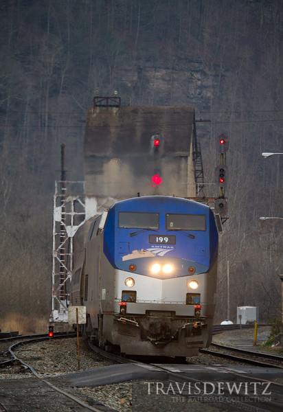 Amtrak 199 wears a unique bright blue nose as it leads the Cardinal through Thurmond, West Virginia.