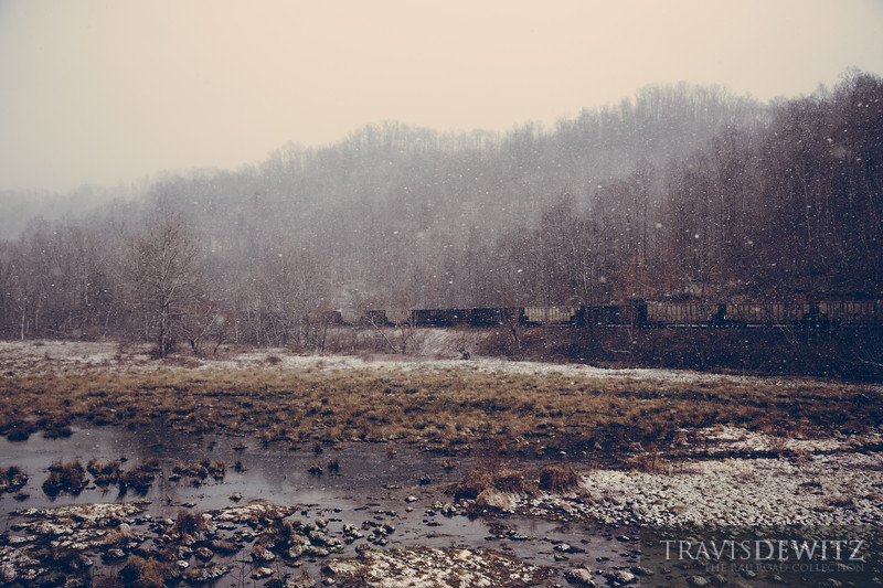 Empty CSX coal hoppers arrice at the Pax loadout during a heavy snow squall.