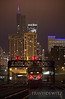 "One of the last Metra passenger trains of the night heads back into Chicago Union Station under ex-PRR signal bridge lit up in front of a Chicago skyline.  Travis Dewitz <a href=""http://www.therailroadcollection.com/latest-works/"" target=""_blank"">The Railroad Collection</a>"