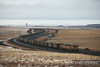Coal mines dot the landscape of the Powder River Basin as train after train transport the black coal out of the basin.