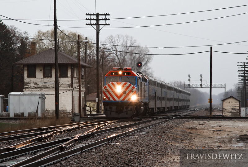 """Metra 611 is one of two remaining EMD F40Cs left in Metra's fleet. A steady rain falls at Rondout while a Metra Passenger train heads north out of Chicago on it's way to Fox Lake.  Travis Dewitz <a href=""""http://www.therailroadcollection.com/latest-works/"""" target=""""_blank"""">The Railroad Collection</a>"""