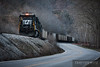 Norfolk Southern 8742 shoves empty coal hoppers back to the Lobata Coal Mine just east of Williamson, West Virginia at dusk.