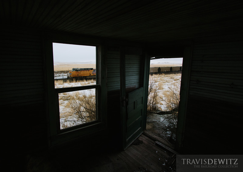An abandoned house sits on the cold windy Powder River Basin prarie as coal trains parade by around the clock.