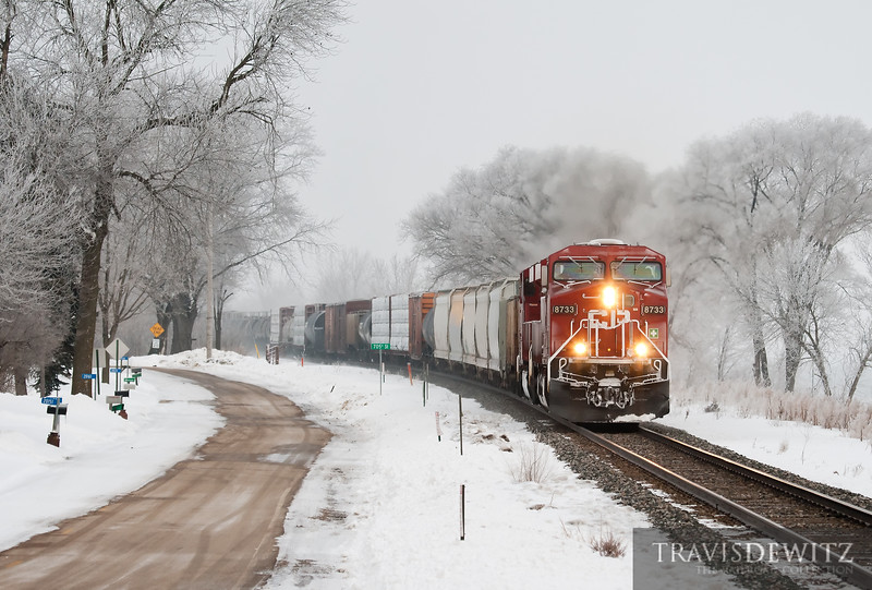 """The frost covers everything in white as a bright red Canadian Pacific freight train flys down the River Sub along the Mississippi River at Reads Landing, MN.  Travis Dewitz <a href=""""http://www.therailroadcollection.com/latest-works/"""" target=""""_blank"""">The Railroad Collection</a>"""