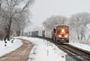 "The frost covers everything in white as a bright red Canadian Pacific freight train flys down the River Sub along the Mississippi River at Reads Landing, MN.  Travis Dewitz <a href=""http://www.therailroadcollection.com/latest-works/"" target=""_blank"">The Railroad Collection</a>"