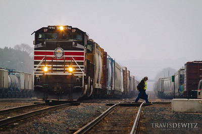 Union Pacific Southern Pacific Lines heritage unit 1996 pulls into Altoona on this foggy day. The crew tiesdown the train and head into the depot.