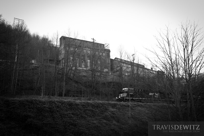 The now abandoned N & W power plant stands above Maybeury, West Virginia and the now Norfolk Southern mainline.