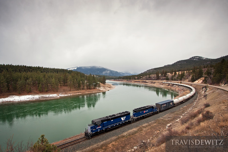 """Montana Rail Link SD45 #318 takes the gas local from Thompson Falls, MT to Missoula, MT seen here along the Clark Fork just west of Plains, Montana.  Travis Dewitz <a href=""""http://www.therailroadcollection.com/latest-works/"""" target=""""_blank"""">The Railroad Collection</a>"""