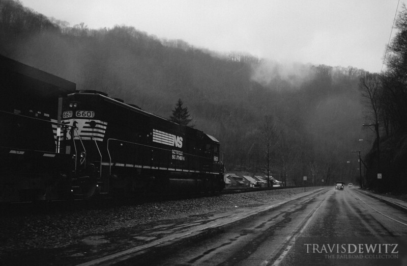 Pacing Norfolk Southern 6601 through the rain along Highway 52 through Keystone, West Virginia.