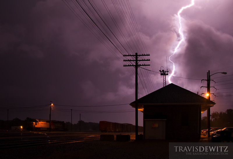 """A close lightning strike flashes above the Union Pacific depot in Altoona, Wisconsin as yard power hunkers down in the yard waiting out the thunderstorm's heavy rains and wind bursts.  Travis Dewitz <a href=""""http://www.therailroadcollection.com/latest-works/"""" target=""""_blank"""">The Railroad Collection</a>"""