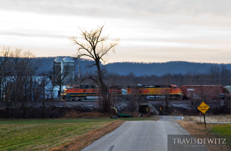 "A BNSF manifest streaks south along the Wisconsin countryside between farms and their fields as the day comes to an end just south of Cochrane.  Travis Dewitz <a href=""http://www.therailroadcollection.com/latest-works/"" target=""_blank"">The Railroad Collection</a>"
